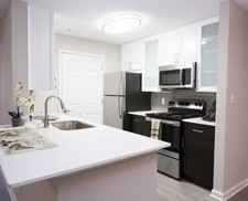 The Point at Perimeter offers the Finest Apartments in Dunwoody, GA with rich cherry wood kitchen cabinetry.
