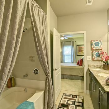 Bathroom Tub with Shower Head Visible