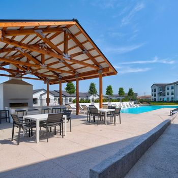 Swimming pool with covered grilling area
