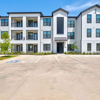 Exterior view of apartment building and parking lot