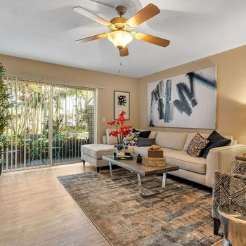 The Dunes Indian Harbour Beach, Florida living room with wood style flooring, ceiling fan, and sliding door to patio