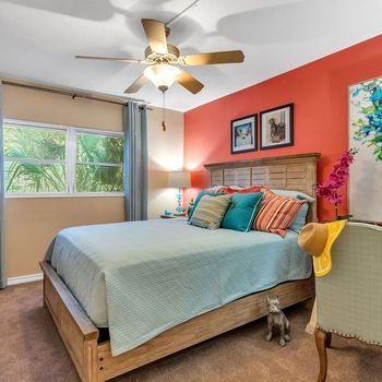 The Dunes Indian Harbour Beach, Florida carpeted bedroom with ceiling fan