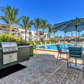 The Dunes Indian Harbour Beach, Florida sparkling swimming pool with grilling station and seating