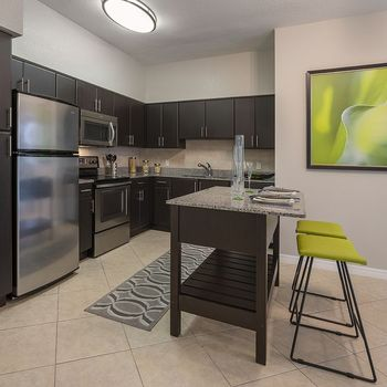 Kitchen with stainless steel appliances and granite countertops.