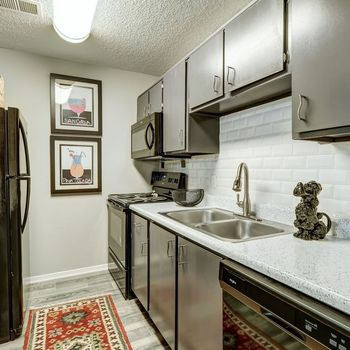 Kitchen with appliances and hard flooring
