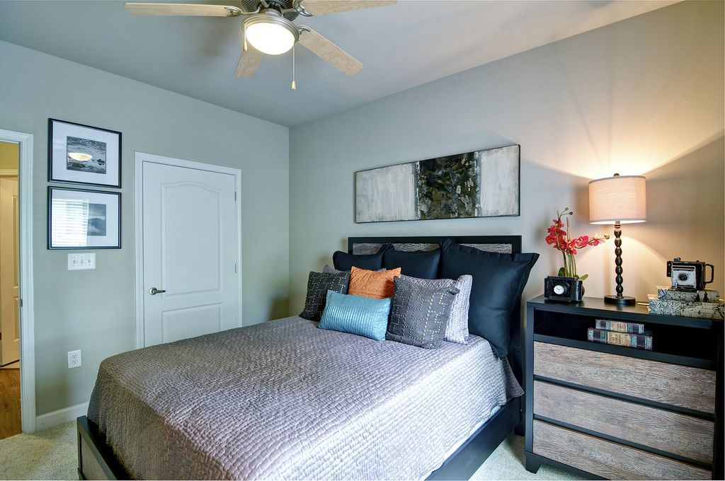 Bedroom with Ceiling Fan and Large Bed and Closet Door