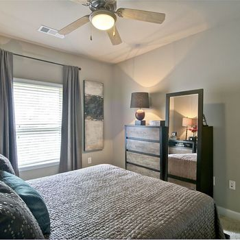 Bedroom with Mirror and Dresser