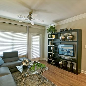 Living Room with Entertainment Center and Ceiling Fan