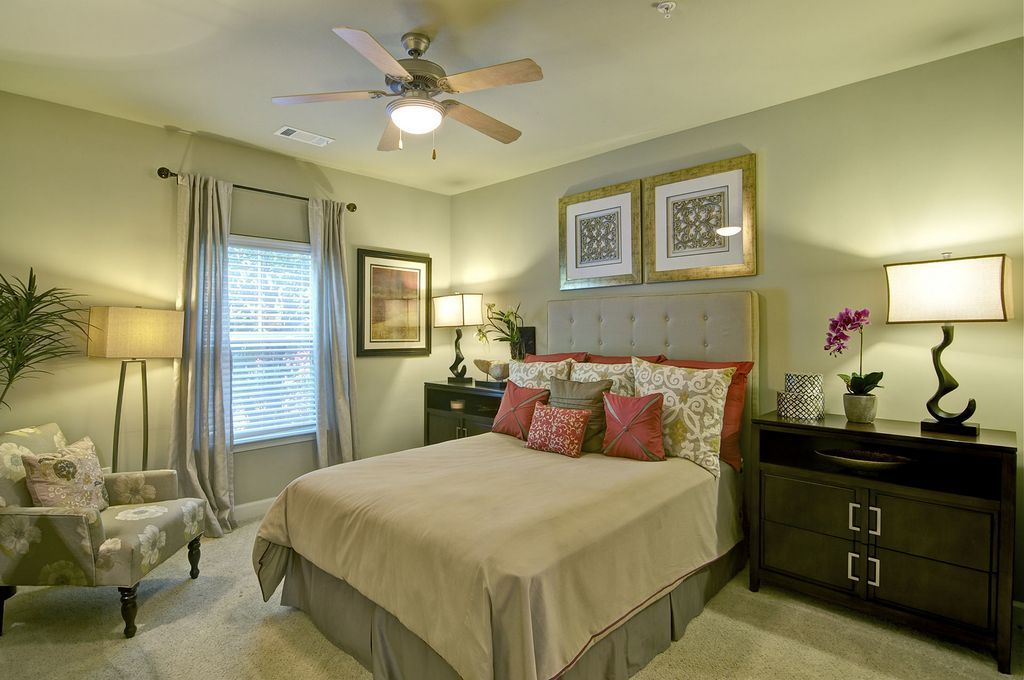 Bedroom with Ceiling Fan and Large Bed and Side Tables