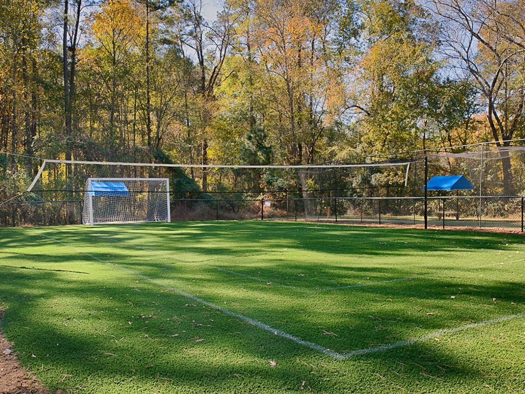 Another View of Sports Field with Volleyball Net and Soccer Goals