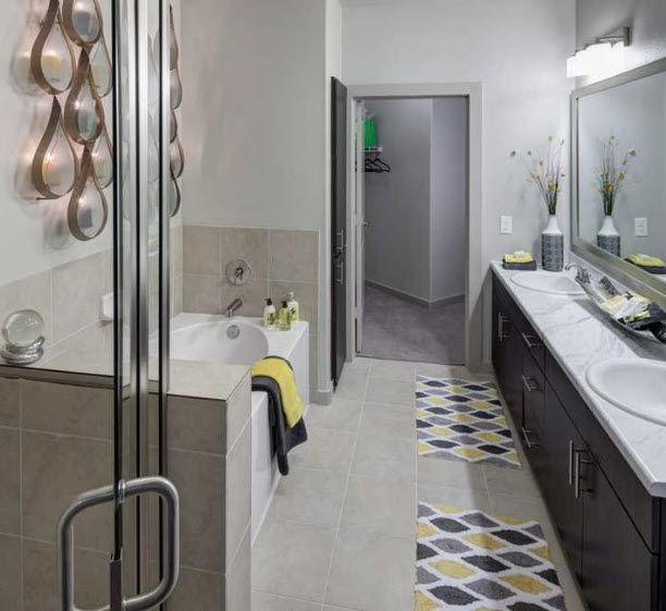 Apartment bathroom with walk-in shower and soaking tub