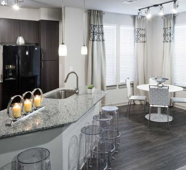 Apartment kitchen with island and view of dining area